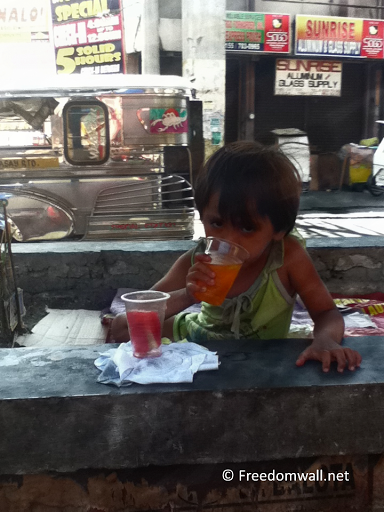 Drinking Child in Taft Avenue