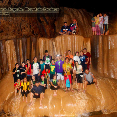 Spelunkers striking a pose at Sumaguing Cave