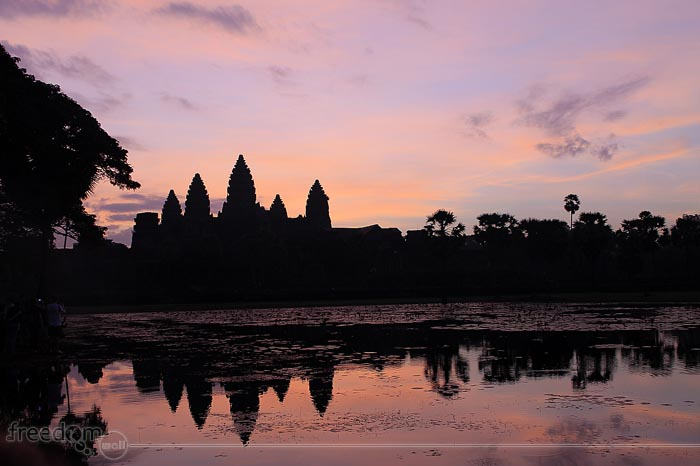 Angkor Wat Sunrise. The sky was covered with thin cloud so we did not witness the burst of colors - just shades of red