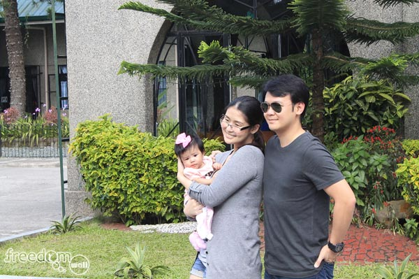 Iwa Moto, Pampi Lacson and their baby posed for a family photo in Holy Spirit Adoration Sisters (Pink Sisters) Chapel