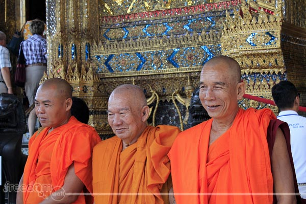 Monks posing for Tourists in the Monastery of the Emerald Buddha, Grand Palace