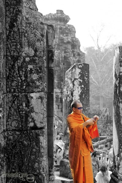 tourist monk at bayon temple