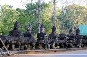 stone guards at angkor thom's south gopura