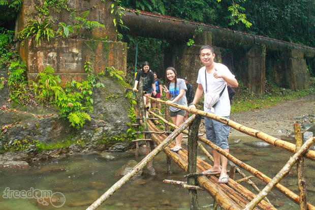 Crossing the makeshift bridge