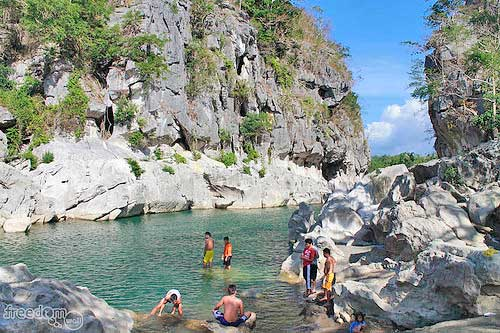 Tourists frequent Minalungao to swim