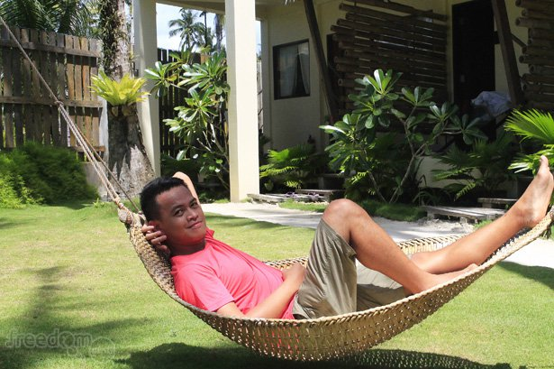 Trying the hammock weaved from local bamboo and/or rattan