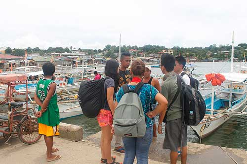 Talking to our boatman at Estancia Feeder Port