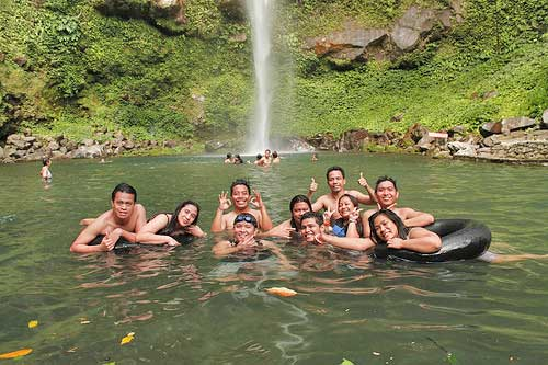 Dipping in the cold waters of Katibawasan Falls