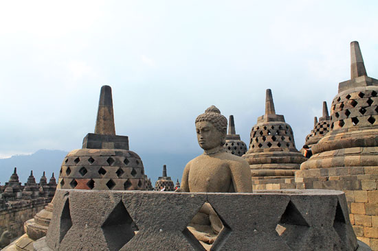 A Buddha statue inside a damaged Stupa in Borobudur