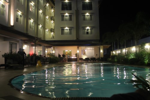 The harvest hotel pool at night
