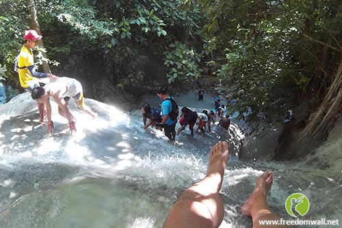 Trekking against the waterfall current at Aguinid
