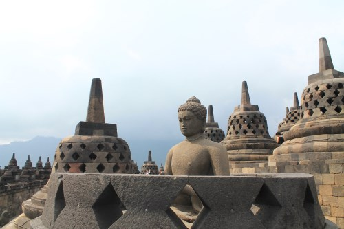 The highest tier of Candi Borobudur is adorned with 72 seating Buddha images housed in perforated stupas