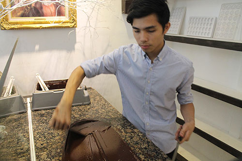 Jonathan, Ms Raquel's son, also conche and mold chocolates for guests