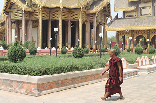 Tourist monk at Thiri Zaya Bumi Bagan Golden Palace