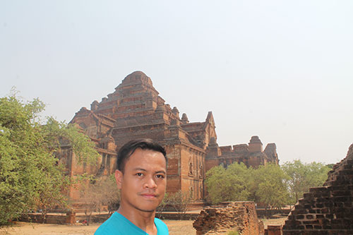 In the background is Dhammayangyi Temple, Bagan's largest