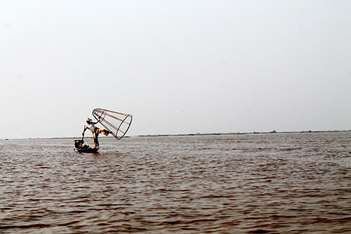 A fisherman ready to cast his net basket