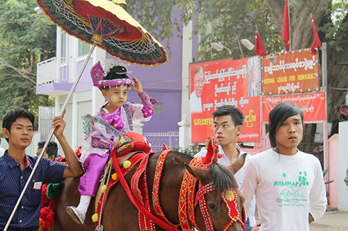 A parade of young Burmese boys in preparation of the Shinbyu or the novitiation ceremony in Nyaungshwe, an adjacent town of Bagan.