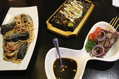 OLA Restobar's seafood marinra, sisig, and beef tapa on barbecue stick