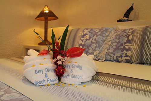 Comfy bed courtesy of Easy Diving and Beach Resort