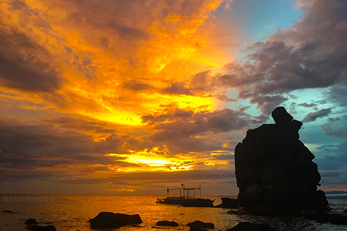 Vivid colors burst as the sun sets in Apo Island