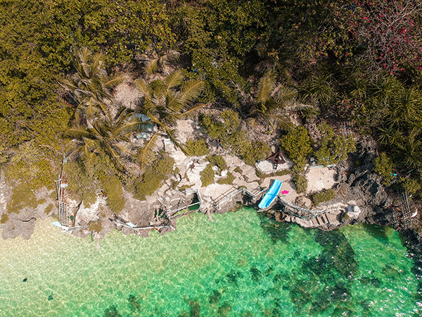 Cliff Jumping at Forest Beach, Kinatarcan Island