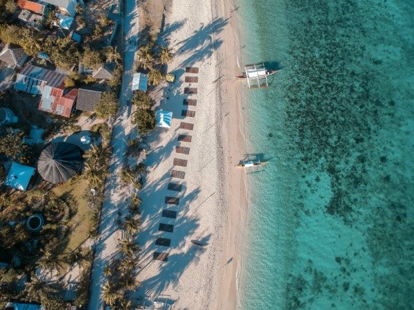 The top view of Kinatarcan Wellness Resort along Pasil Beach, Kinatarcan Island
