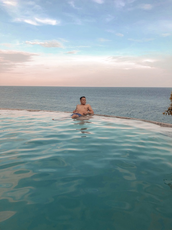 ian limpangog at antulang beach resort infinity pool