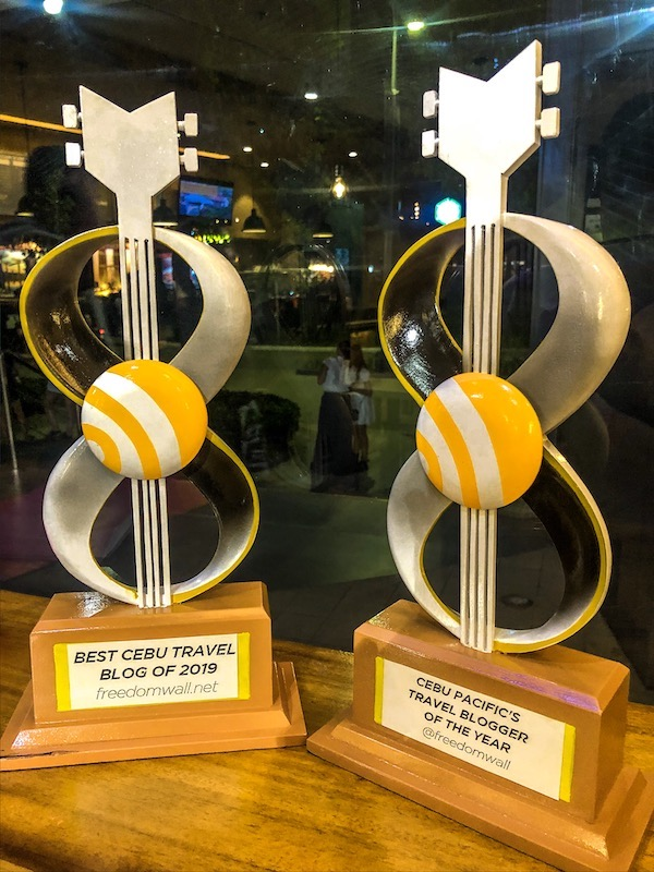 Best Cebu Travel Blog and Cebu Pacific's Travel Blogger of the Year trophies